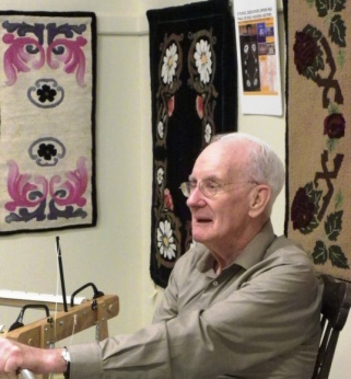 "Founder Hugh Conrod sits in front of several hooked Garrett ""mystery patterns""."